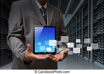 business man and tablet computer in server room
