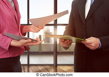 Business man and woman hand holding clipboard and paper