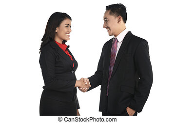 Business man and woman shake hand