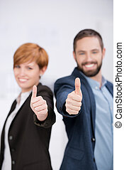 Business Man And Woman Showing Thumbs Up Sign - Portrait of...