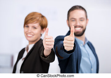Business Man And Woman Showing Thumbs Up Sign