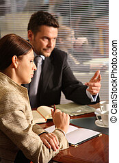 business man and woman talking in the office - business ...