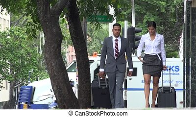 Business Man and Woman Traveling