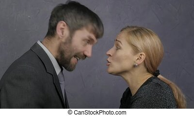 business man and woman yell at each other. conflict...