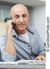business man answering a phone call