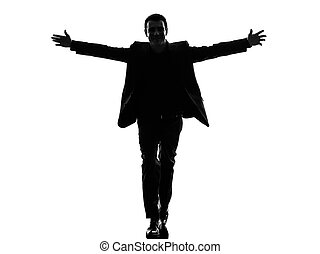 business man arms outstretched silhouette
