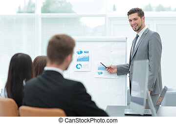 Business man asking question during his colleagues presentation