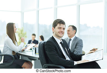 business man at office with his business team working behind