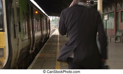 Business man at Train station