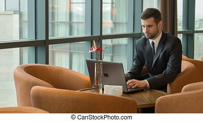 Business man at work time with laptop