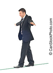 Business man balance - Business man on tightrope concentrate...