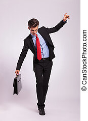business man balancing on rope
