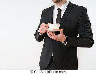 business man body side in black suit with cup of coffee on white background