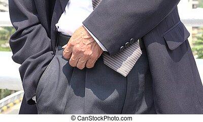 Business Man Checking Pocket