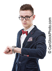 Business man checking time and looking to wristwatch on his hand