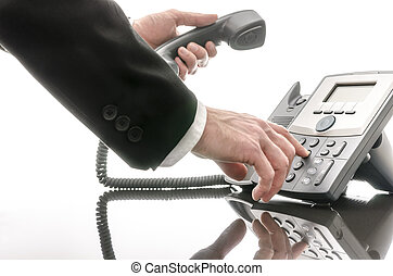 Business man dialing a phone number - Cropped view of a...