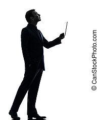 business man digital tablet looking up silhouette