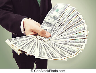 Business Man Displaying a Spread of Cash over Vintage Green...