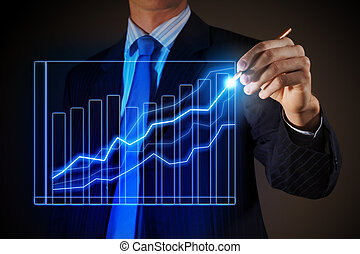 Business man drawing graphics - Closeup image of businessman...
