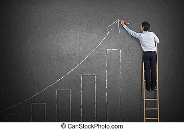 business man drawing growth chart - business man standing on...