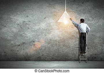 Business man drawing lamp