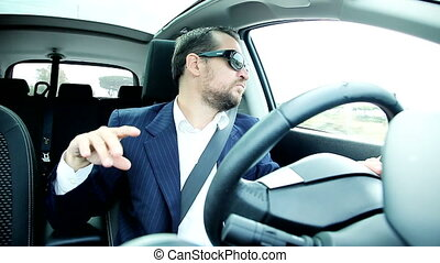 Business man driving and dancing