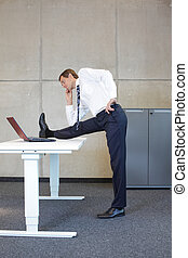 business man exercising - office occupational disease...