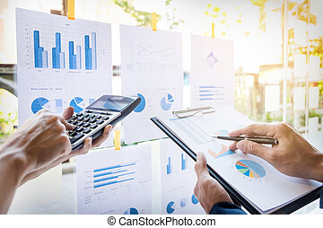 business man financial inspector and secretary making report, calculating or checking balance. Internal Revenue Service inspector checking document. Audit concept.
