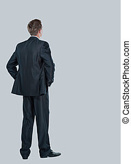 business man from the back - looking at something over a white background.