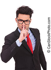 business man gesturing shut up - young business man showing...