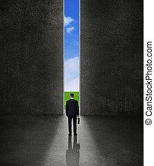 Business man going through wall to shining future - success ...