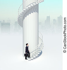 business man going upstairs in curved staircase to success