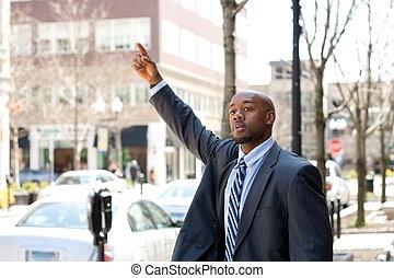 Business Man Hailing a Taxi Cab