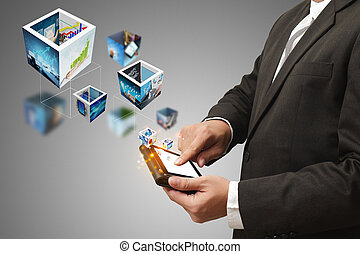 business man hand holding a touch pad computer and 3d streaming images