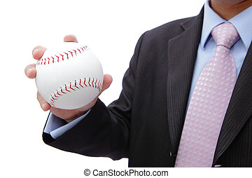 Business man hand holding baseball