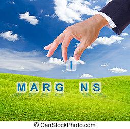 business man hand made margins word buttons on green grass meadow
