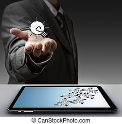 pixel light bulb icon and tablet computer - business man...