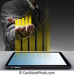 hand shows virtual gold graph with tablet computer