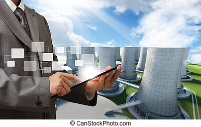 nuclear power plant - business man hand tablet computer and...