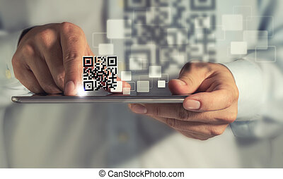 tablet computer Qr code scan - business man hand using ...