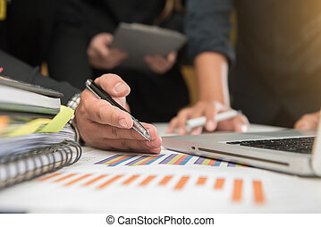 business man hand working on laptop computer with digital layer business graph information diagram on wooden desk as concept