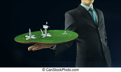 Business man has on hand green energy concept build...