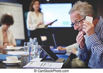 Business man having an emergency phone call