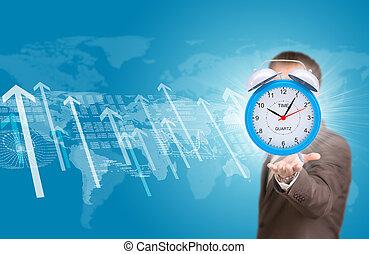 Business man hold alarm clock
