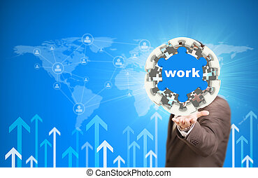 Business man hold puzzle sphere with Work label
