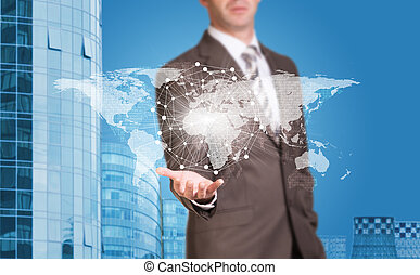 Business man hold world map and wire-frame sphere in hand....