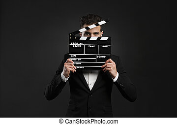 Business man holding a clapboard - Handsome young man...