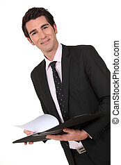 Business man holding a clipboard