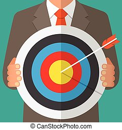 Business man holding a dart board with a direct hit on target