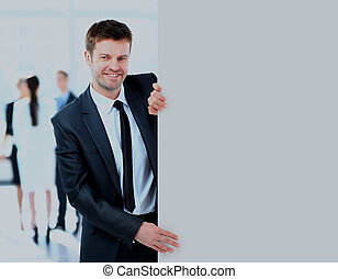 Business man holding a long blank banner